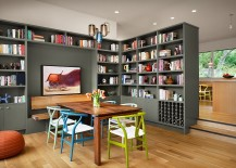 Colorful collection of wishbone chairs and gorgeous gray bookshelves add to the charm of this dining room 217x155 Bibliophile Nirvana: 25 Dining Rooms That Serve Up a Good Read