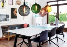 Colorful orbs above the dining table breathe life into the curated contemporary dining room 217x155 Dazzling Feast: 21 Creatively Fun Ways to Light Up the Dining Room