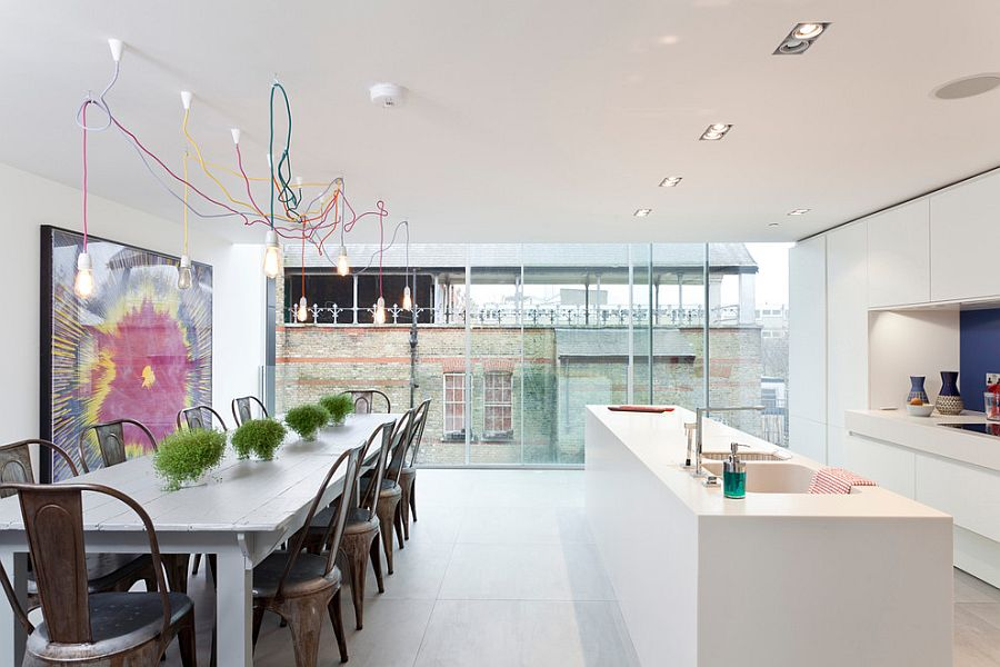 Multi Colored Wires And Edison Bulbs Create A Fascinating Lighting Fixture In The Scandinavian Dining