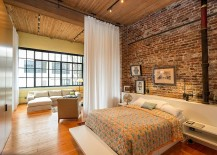Contemporary and industrial elements come together elegantly in this spacious bedroom [Design: Crescent Builds]