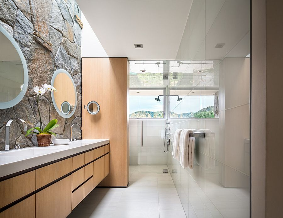 Contemporary bathroom combines glass tile with the classic stone wall [Design: studio bracket]