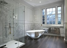 Contemporary bathroom in neutral hues with brilliant lighting around the bathtub
