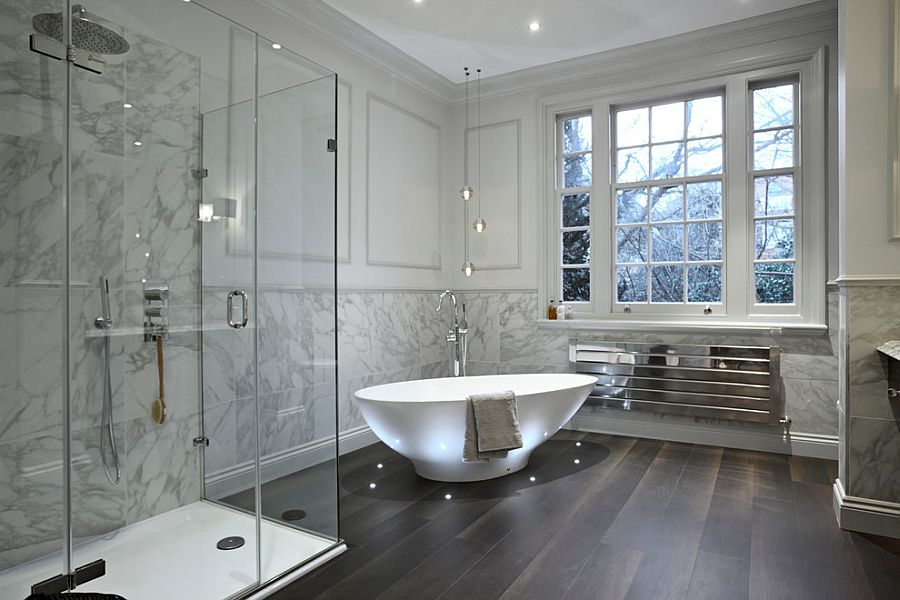 Contemporary bathroom in neutral hues with brilliant lighting around the bathtub [Design: Boscolo Interior Design]