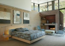 Contemporary bedroom with cozy fireplace and corner shelving
