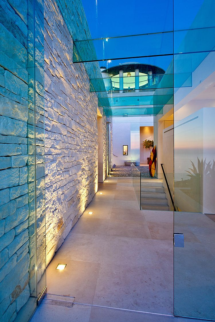 Contemporary entry of stylish San Diego home with in-floor lighting [From: Ron Neal Lighting Design]