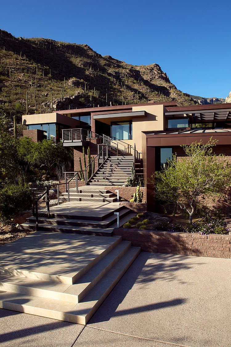 Contemporary entry of the Tucson home with staircase leading to the main living level