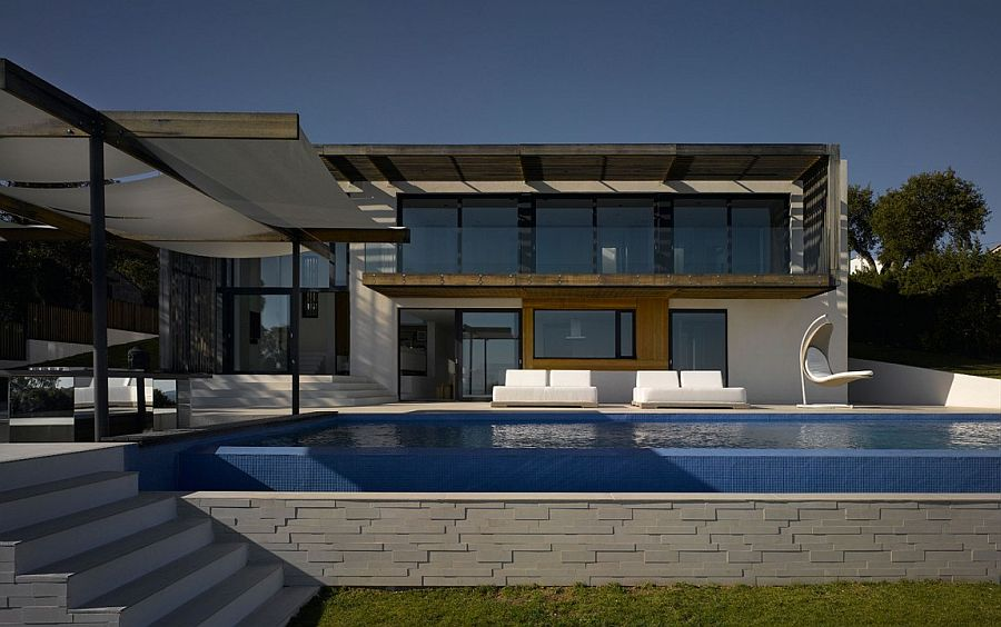 Contemporary pool area and deck of the lavish French Villa