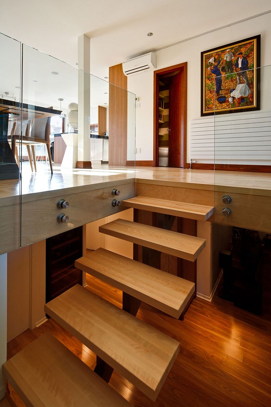 Contemporary wooden staircase leading to the lower private level of the Montreal home