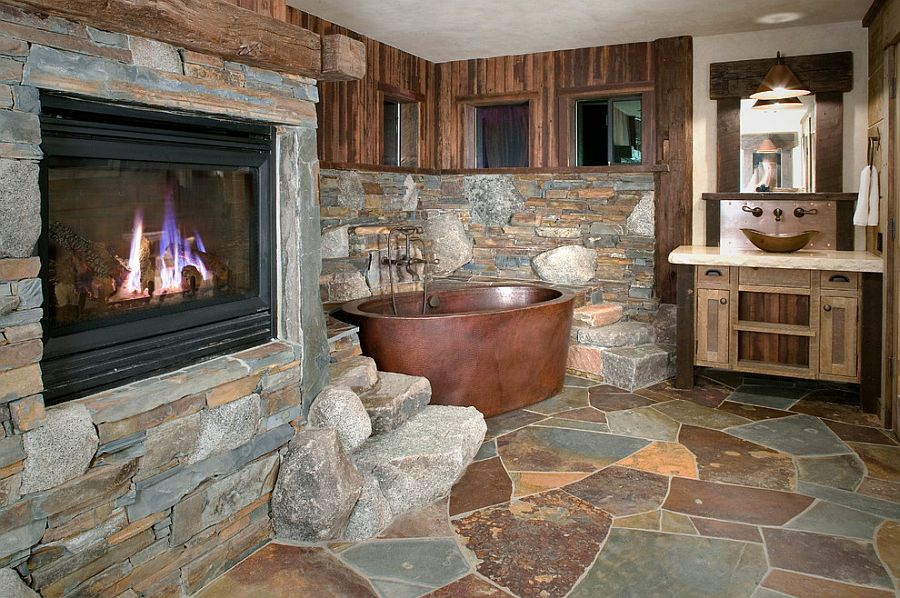 Copper bathtub and Flagstone Slate create a fabulous, rustic bathroom [Design: High Camp Home]