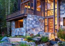 Copper roof and natural dry-stack stone give the mountain home a unique presence