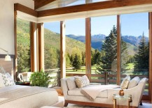 Corner-windows-of-the-bedroom-with-walnut-trims-open-it-up-towards-the-mountain-view-outside-217x155