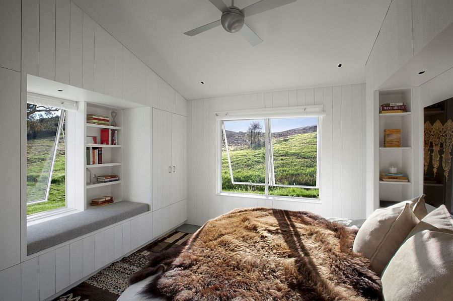 Cozy bedroom in white with window seat and gorgeously framed views