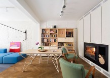 Cozy-fireplace-in-the-living-room-also-serves-the-dining-space-workarea-217x155