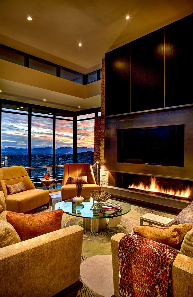 Cozy living room of the mountain home with modern fireplace and stiunning views