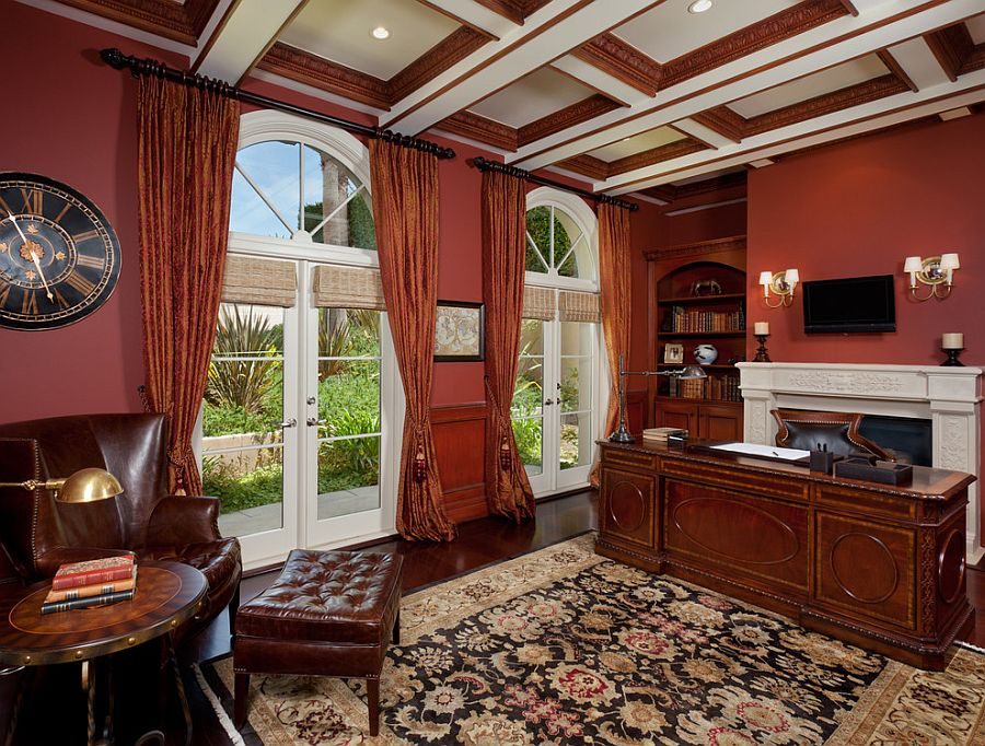 Crimson walls and coffered ceiling steal the show in this transitional home office