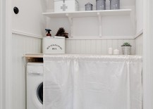 Crisp, clean laundry room with a white sheet to hide washer and dryer