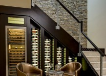 Custom built cooler with LED lighting for the wine cellar under stairs