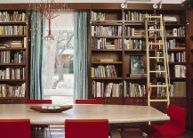 Custom chandelier and fabulous red chairs add color to the home library dining room