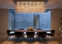 Custom-crafted cascading chandelier steals the show in this LA dining room