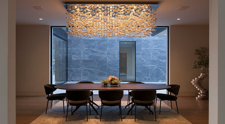 Custom-crafted cascading chandelier steals the show in this LA dining room [Design: Paul McClean - McClean Design]