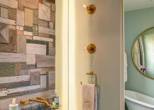Custom crafted reclaimed wood wall doubles as an artistic addition in the contemporary bathroom