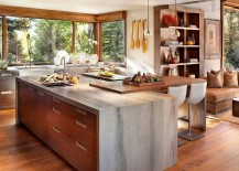 Custom walnut cabinets and Wild Sea Granite countertops inside the rustic modern kitchen