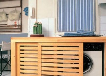 Custom-wood-box-with-sliding-doors-to-conceal-washer-and-dryer-217x155
