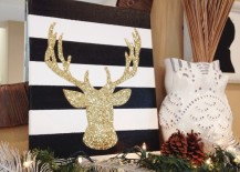 DIY gold glitter deer head canvas 217x155 20 Chic Holiday Decorating Ideas with a Black, Gold, and White Color Scheme