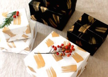 DIY holiday wrapping paper in gold black and white 217x155 20 Chic Holiday Decorating Ideas with a Black, Gold, and White Color Scheme