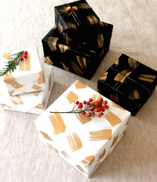 DIY holiday wrapping paper in gold, black, and white