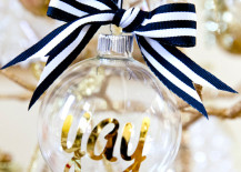 DIY personalized glass ornaments in gold with black and white ribbon 217x155 20 Chic Holiday Decorating Ideas with a Black, Gold, and White Color Scheme