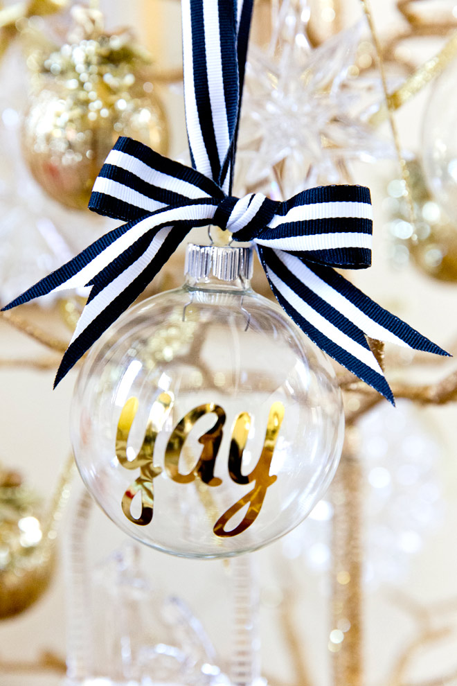 DIY personalized glass ornaments in gold with black and white ribbon