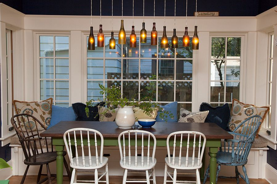 DIY wine bottle lighting above the cozy dining space [Photography: Whitney Lyons]