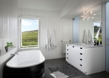 Dark classic bathtub set against a white backdrop in the bathroom