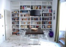 Dark-modest-dining-table-stands-in-contrast-with-the-rest-of-the-room-217x155