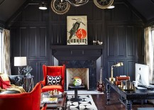 Dark sophistication and smashing decor additions create a stunning home office