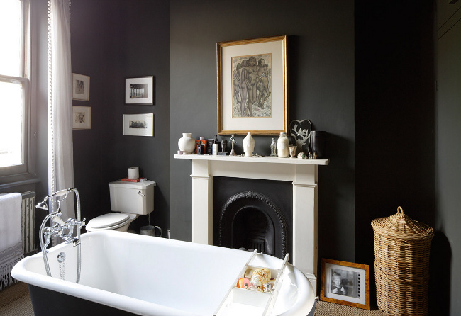 ... Dark walls and tub with a stunning black and white fireplace & 16 Fireside Bathtubs for a Cozy and Luxurious Soak
