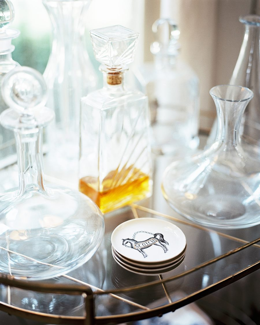 Decanters on a gold-toned bar cart
