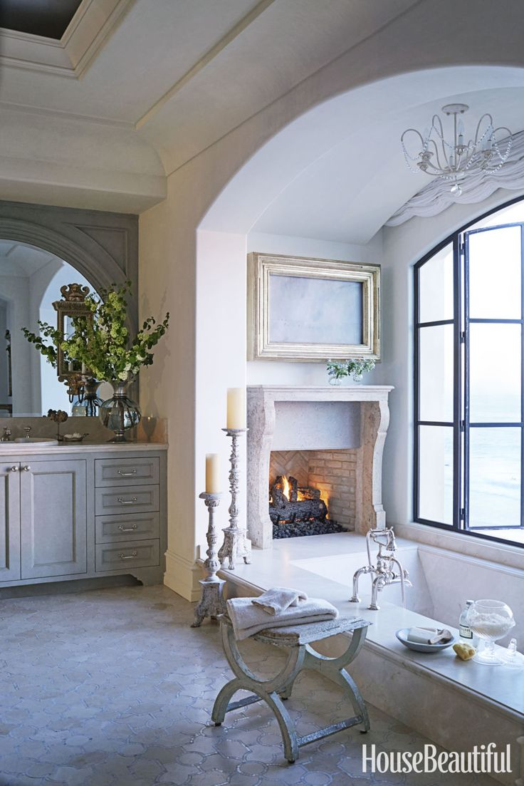 charming master bathroom fireplace | 16 Fireside Bathtubs for a Cozy and Luxurious Soak