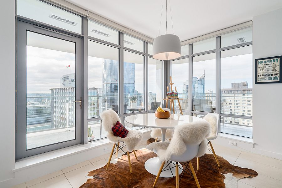 Dining area with classic Saarinen table and smart city view