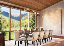 Dining room with unabated views of Vail slopes and a sparkling chandelier