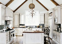 Distressed look of the cabinets steals the show in this spacious kitchen