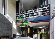 Double height dining room with a wall of books not for the faint of heart