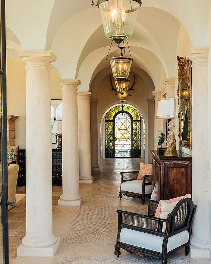 Dramatic hallway seems even more classical thanks to the lighting fixtures and antique mirror