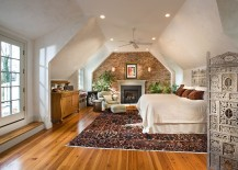 Eclectic and spacious bedroom with burnished plaster and exposed brick walls [Design: McNally Interiors]