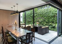 Elegant-dining-area-with-mored-pendants-in-gray-and-classic-dining-table-chairs-217x155