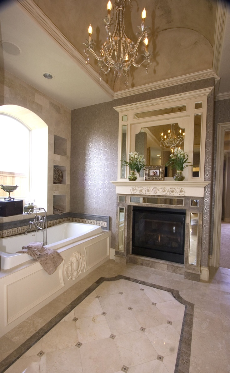 Elegant fireplace next to tub