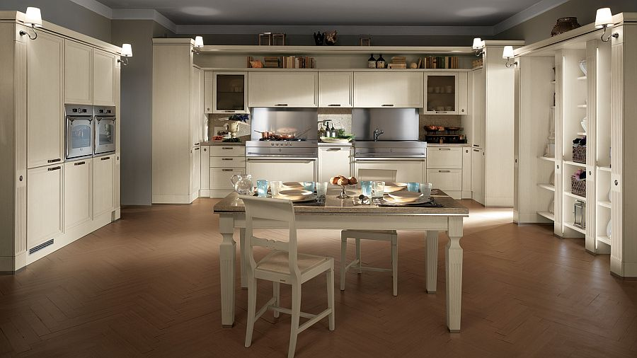Elegant white backdrop and central dining space turn this Scavolini kitchen into an absolute dream