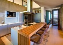 Ergonomic modern kitchen design with central island and breakfast nook
