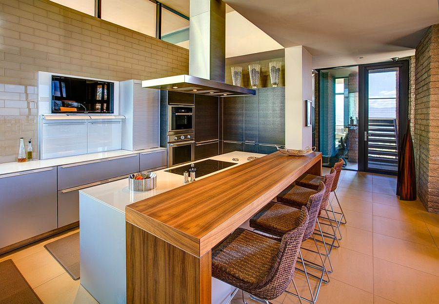 Ergonomic modern kitchen design with central island and breakfast nook